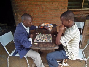 """EBCoM students focussed on their game of bottle top drafts"""""""
